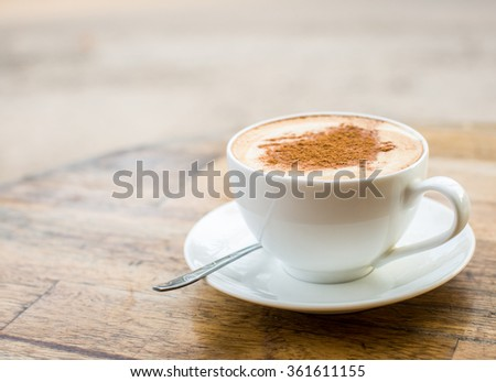 Loving coffee. Cup of fresh cappuccino  with heart sign - stock photo