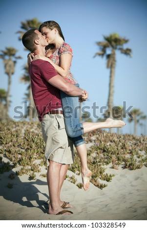 Loving couple at the beach - stock photo