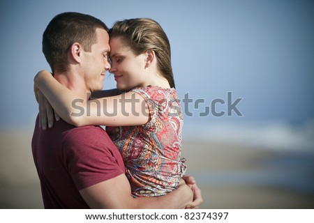 Loving couple at the beach - stock photo