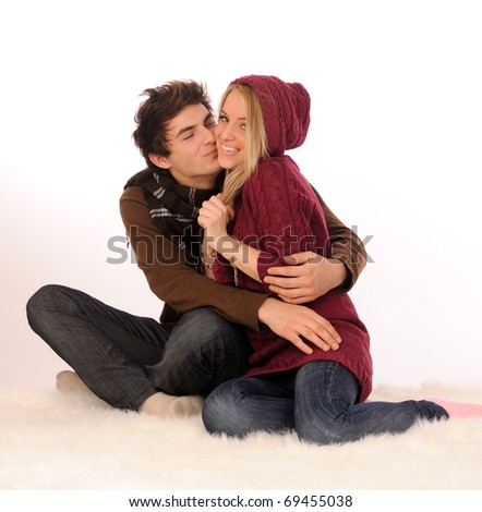Loving couple embracing on white. - stock photo