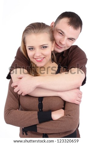 Loving couple embracing on white background - stock photo