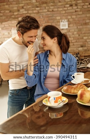 Loving couple having breakfast together at home. - stock photo
