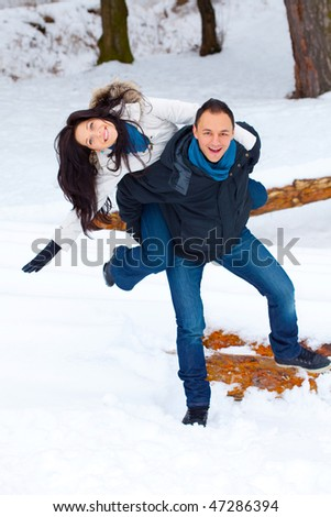 Loving couple having fun, enjoying their winter holiday together. - stock photo
