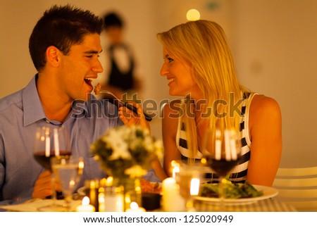 loving couple having romantic dinner in a restaurant - stock photo