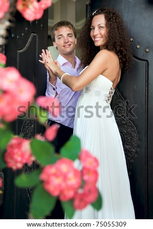 Loving couple hold each other's hands - stock photo