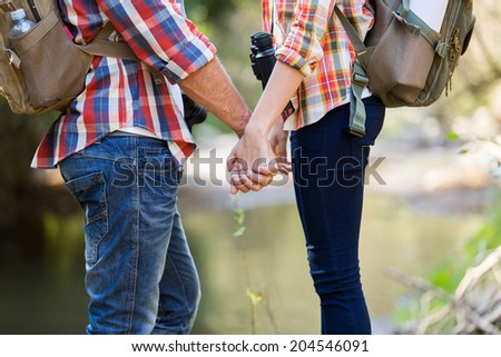 loving couple holding hands in mountain - stock photo