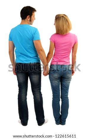 Loving couple holding hands isolated on white - stock photo