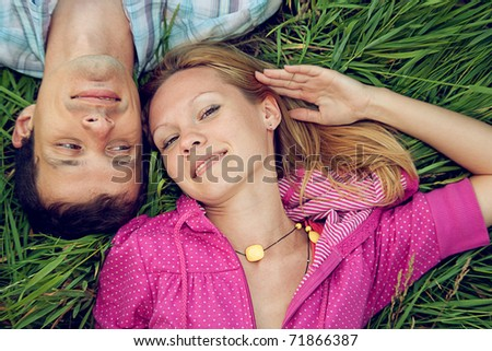 loving couple in a field - stock photo