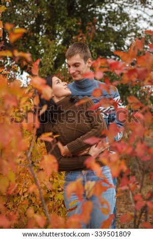 loving couple in a park on the outdoors. Autumn Day