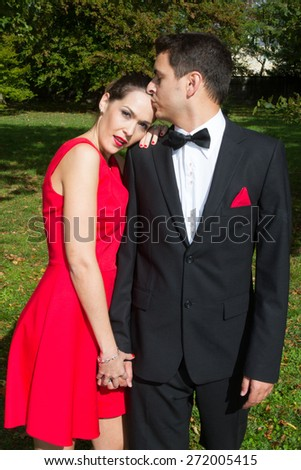 Loving couple in bright clothes dancing on the park - stock photo
