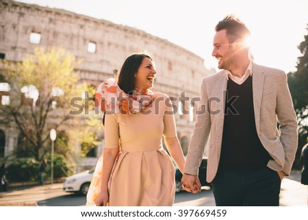 Loving couple in front of the Colosseum in Rome - stock photo