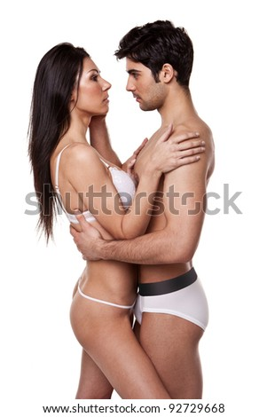 Loving Couple In Tender Embrace and wearing underwear standing looking at each other - stock photo