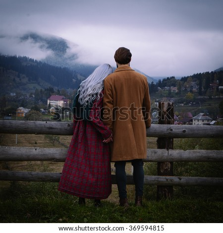 Loving couple in the autumn mountains - stock photo