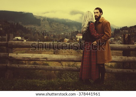 Loving couple in the autumn mountains