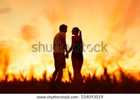 Loving couple in the park.  - stock photo