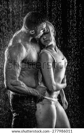 loving couple in the rain - stock photo