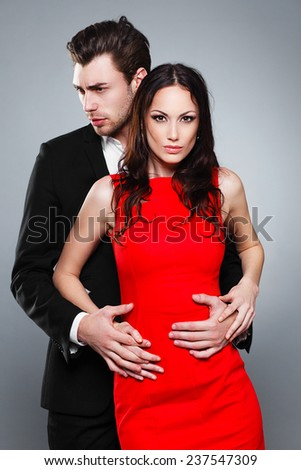 loving couple in the studio, red dress, fashion