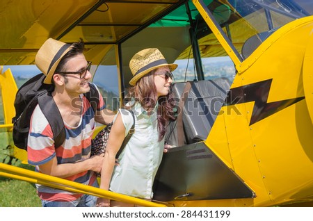 loving couple is ready to leave for their trip - holidays and trasportation concept - stock photo