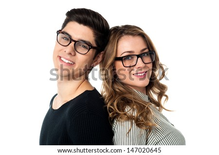 Loving couple leaning against each other - stock photo
