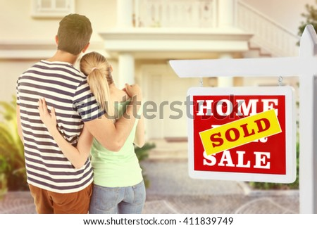 Loving couple looking at their dream house - stock photo