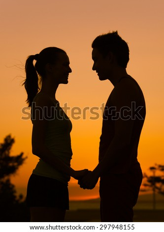 Loving couple looking into each others eyes.  - stock photo