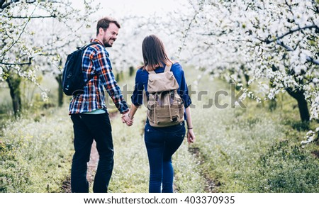 Loving couple/ Loving couple enjoying in nature. Young couple holding hands. - stock photo