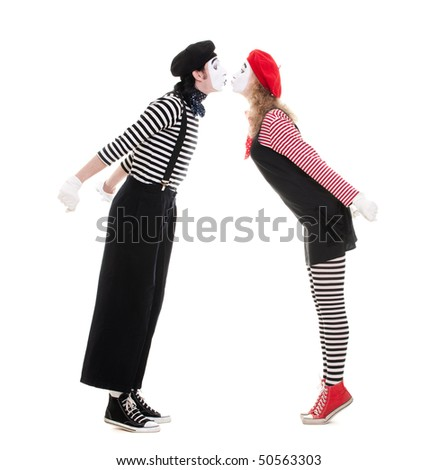 loving couple of mimes kissing. isolated on white background - stock photo