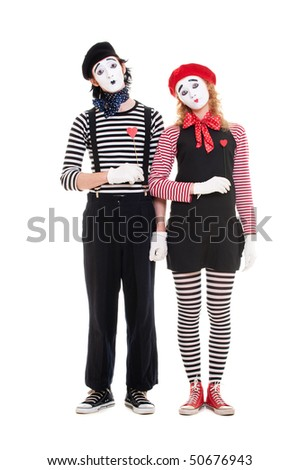 loving couple of mimes with red hearts. isolated on white - stock photo