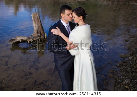 Loving couple of people at the river - stock photo