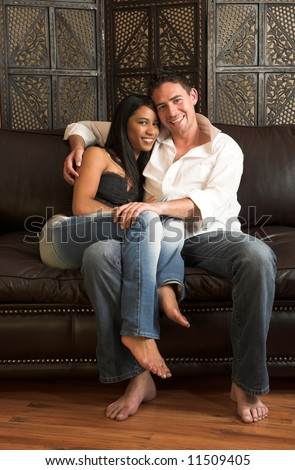 Loving couple on a brown leather couch