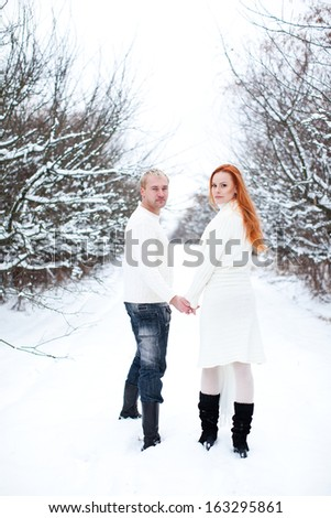 Loving couple on a winter landscape