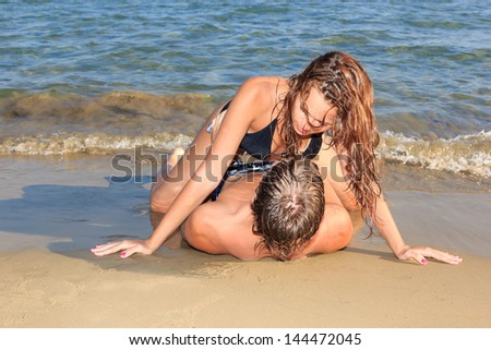 loving couple on the beach in the summertime - stock photo