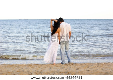 loving couple on the seaside - stock photo