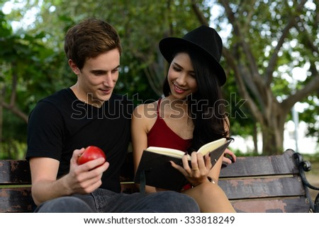 Loving couple outdoors - stock photo