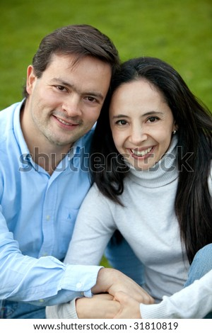 loving couple portrait looking happy and smiling outdoors