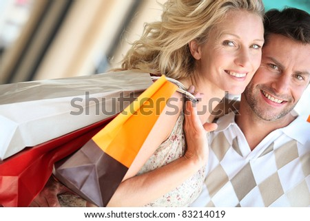 Loving couple shopping - stock photo