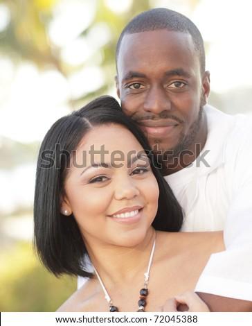 Loving couple smiling - stock photo