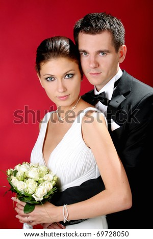 Loving couple standing in the studio
