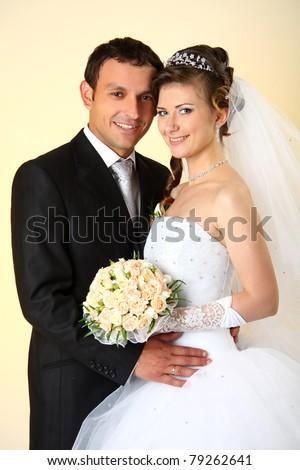 Loving couple standing in the studio - stock photo