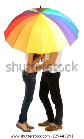Loving couple standing with umbrella isolated on white - stock photo