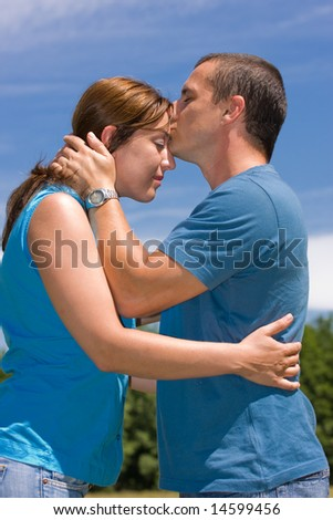 Loving couple under summer blue sky