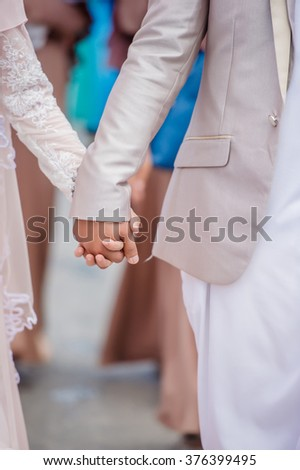 Loving couple walking and embracing ,Bride and Groom wedding day - stock photo