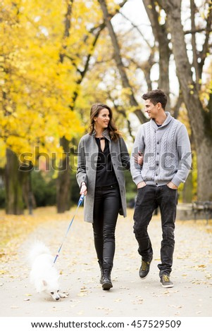 Loving couple walking in the autumn park