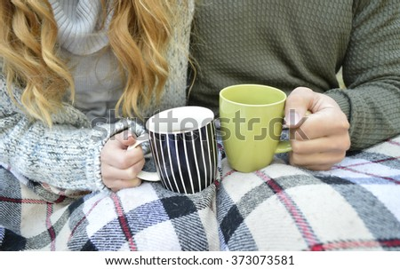 Loving couple with hot drinks.Young couple drinking tea, close-up.Valentine's Day - stock photo
