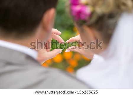 Loving couple with wedding rings in hands