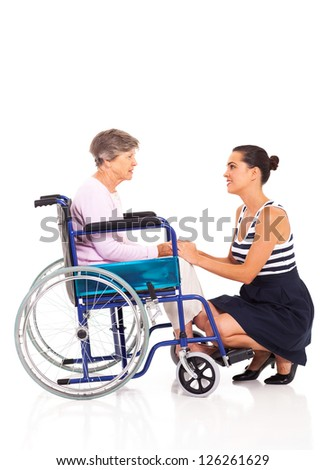 loving daughter talking to disabled senior mother on white background - stock photo