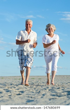 loving elder couple on a background of clear sky - stock photo