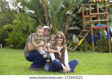 Loving Family, Father, Mother And Their Children Having Fun Outdoors