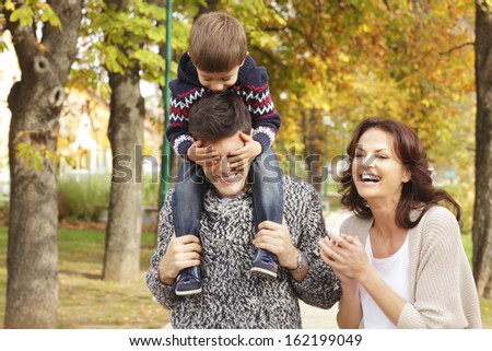 Loving family walking in the park. Shallow focus. - stock photo