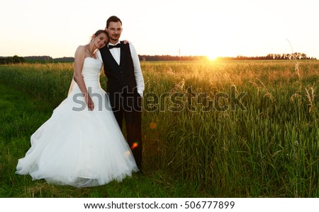 Loving fresh married couple at sunset